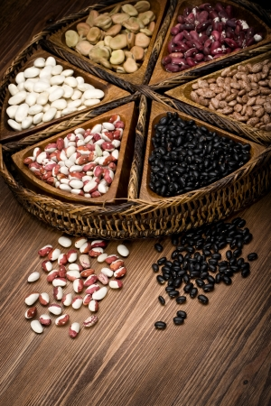 roman beans: mix of beans and peas on a wooden plate