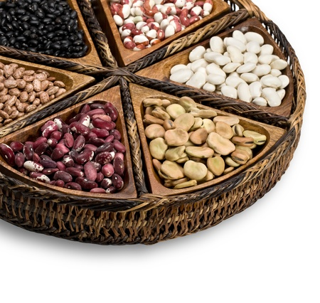 mix of beans and peas on a wooden plate photo