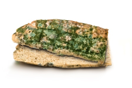 mouldy: Mouldy bread loaf over a white background. Stock Photo