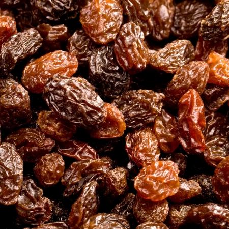 Brown raisins close up background photo