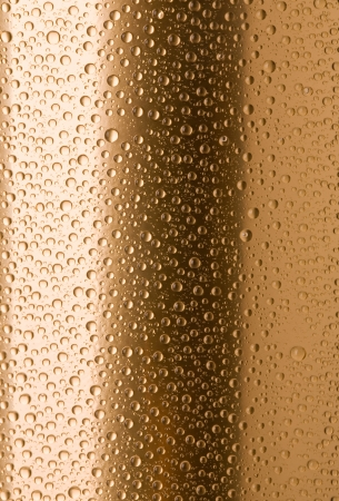 bronze texture: Abstract macro of water drops over yellow background