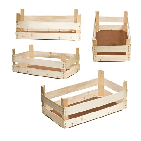vegs: Empty wooden crates on white background