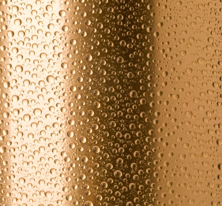 gold drops  beer bottle macro photo