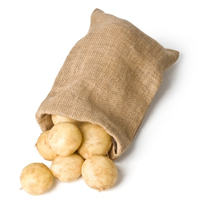 jute: potatoes in burlap sack on white background with clipping path Stock Photo