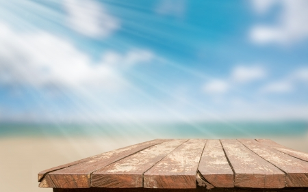 Empty wooden table top against a blue sky