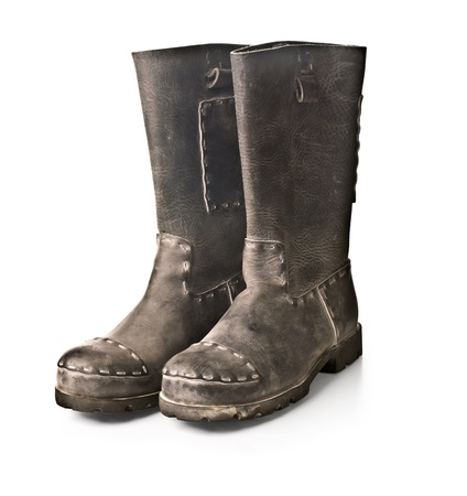 coarse mens boots against a light background photo