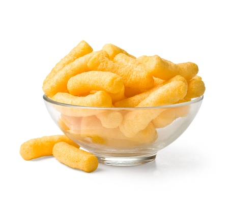 Cheese curls in bowl isolated on a white background