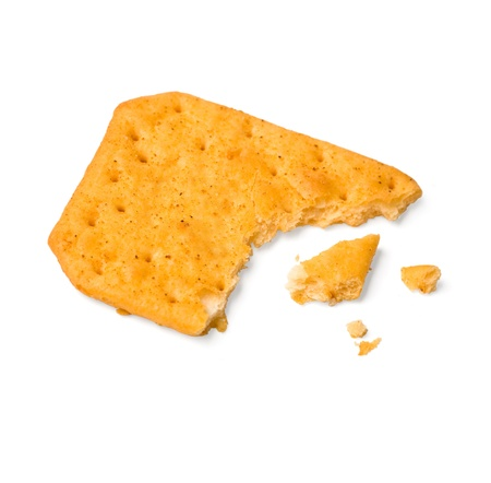 disintegrate: a piece of cracker on white