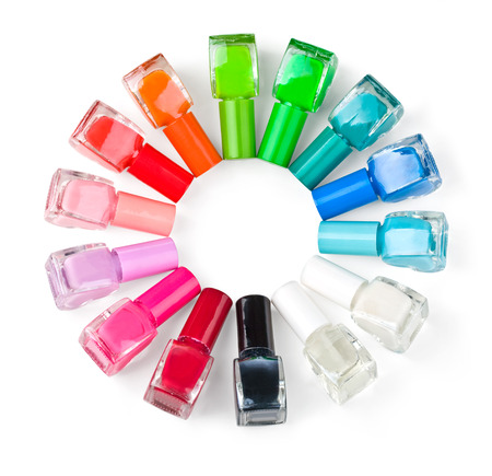 fangle: Colored nail polish bottles stacked circle on a white background  Stock Photo