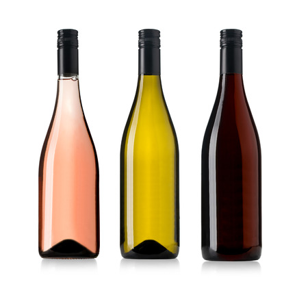 wines:  white, rose, and red wine bottles set isolated on white Stock Photo