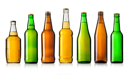 unopened: Set of full beer bottles with no labels isolated on white background