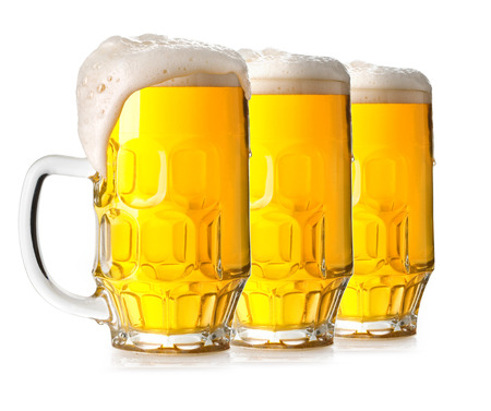 Frosty fresh beer collection with foam isolated background photo