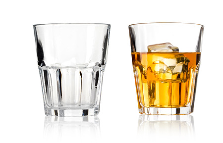whisky: Glass of scotch whiskey and emty glass on a white background Stock Photo