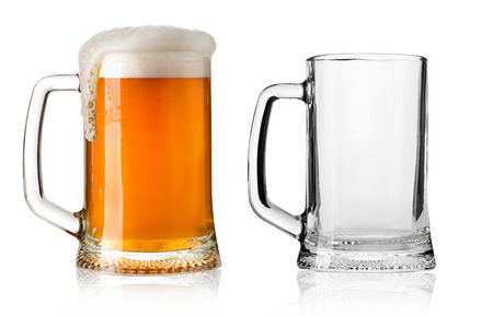 Two Mugs beer with cap of foam and Empty isolated on white background photo