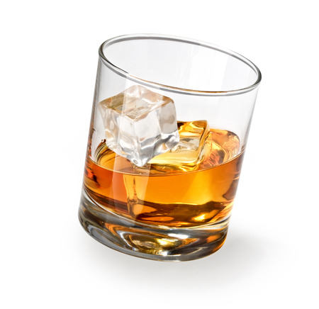 shot glass: Glass of scotch whiskey and ice on a white background Stock Photo