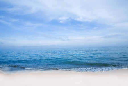 shore line: Blue sea with waves and sky with airy clouds