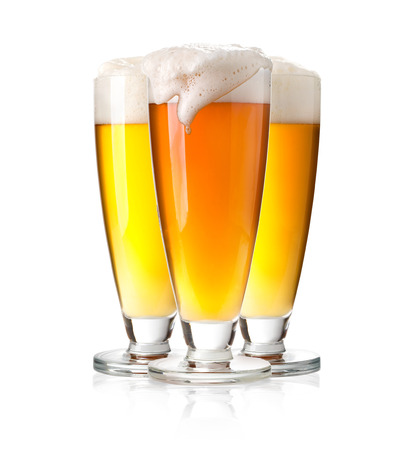 un bottled: Frosty glass of beer with foam isolated on a white background Stock Photo