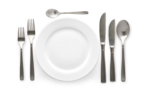Place setting with plate, knife and fork  on white background