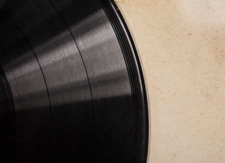 Old vinyl record in a paper case close up photo