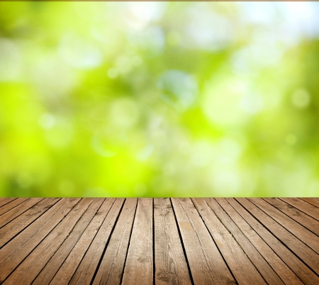 wooden deck: Empty wooden deck table with foliage bokeh background