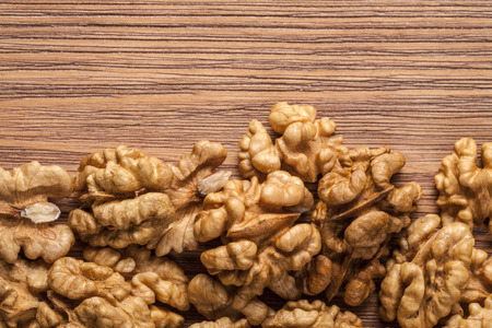arabian food: Walnut kernels  on rustic old wooden table Stock Photo