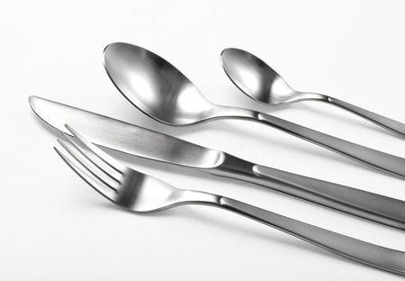 Cutlery set with Fork, Knife and Spoon isolated with clipping path photo