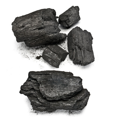 warmness: many pieces of charcoal isolated on white background