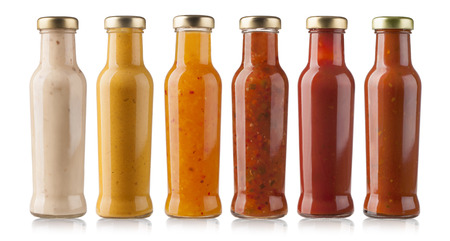 tomato catsup: the various barbecue sauces in glass bottles