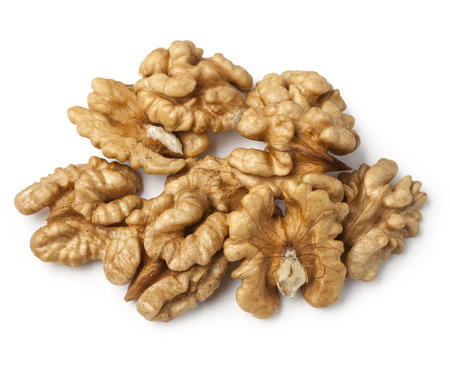 walnut half heap on white background   photo