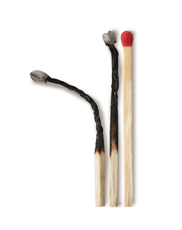 Close-up of a red match isolated on a white background photo