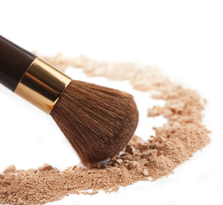 Isolated make-up powder with brush on white background Stock Photo