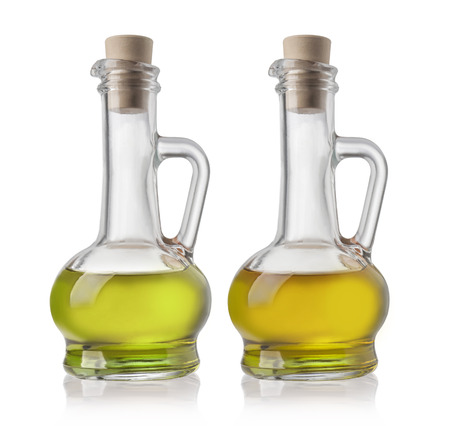 olive vegetable oil in glass pitcher isolated on white photo
