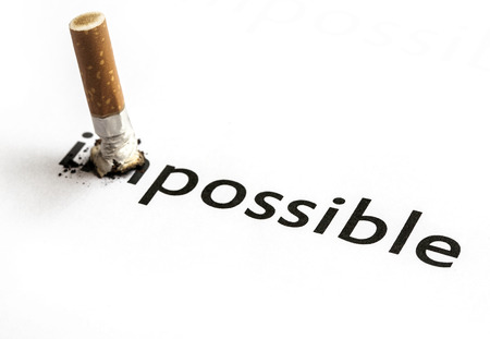 anti tobacco: Changing the word impossible to possible  Stock Photo