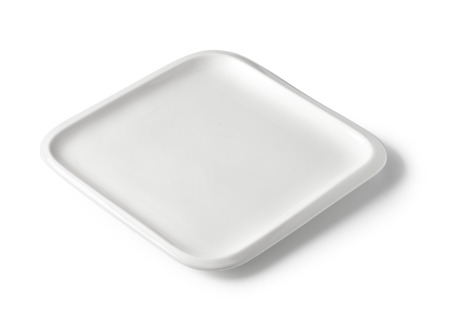 White empty rectangular plate of porcelain on a white background  with clipping path photo