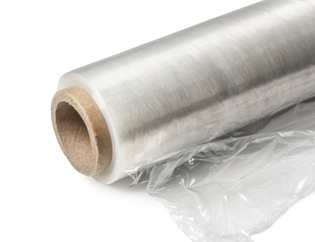 Roll of wrapping plastic stretch film. Close-up. Isolated on white background.With clipping path Stock Photo