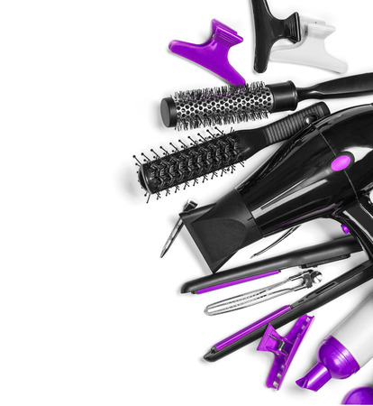 Stylist: Instrumento de peluquería en el fondo más blanco