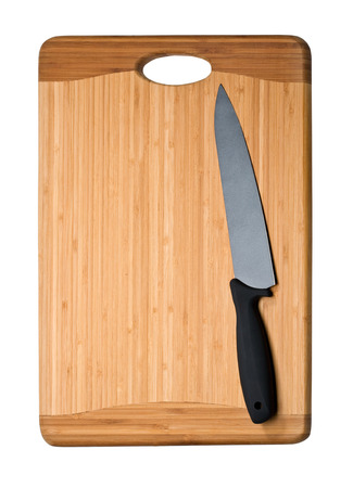 Knife on cutting board isolated on white photo