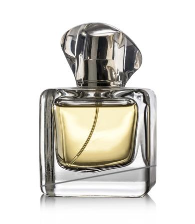 クリッピング パスと、白い背景の上の香水瓶