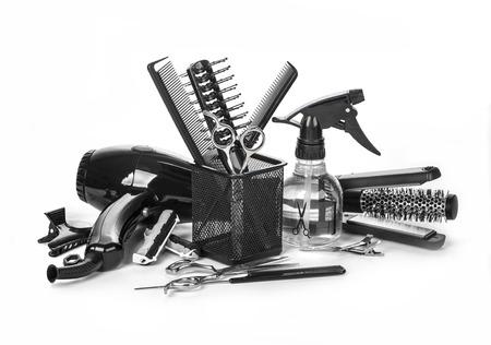secador de pelo: Instrumento de peluquería en el fondo blanco