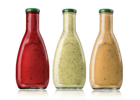 tomato catsup: the various barbecue sauces in glass bottles  Stock Photo
