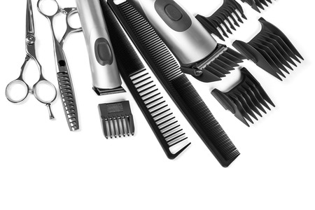scissors and combs isolated on white background photo