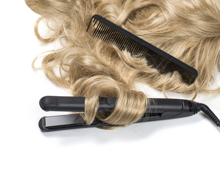 combed: Curly blond hair with curling iron isolated on white