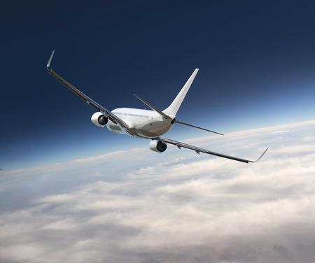 jumbo jet: Heavy jumbo jet airplane flying above the clouds Stock Photo
