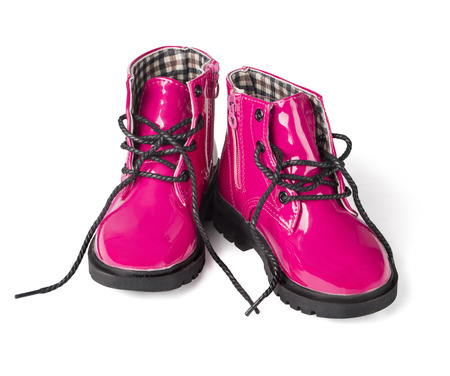 kids dress: pink child boots white isolated with clipping path Stock Photo