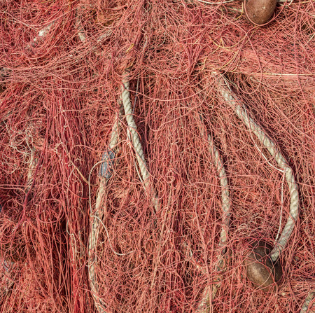 Pile of fishing nets on a quay Stock Photo