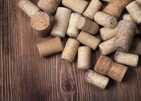 alcoholic drink: Bunch of wine corks on wooden table Stock Photo