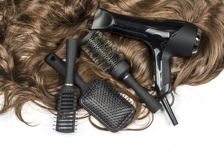 black barber: hairdressers tools on a background of the brown hair