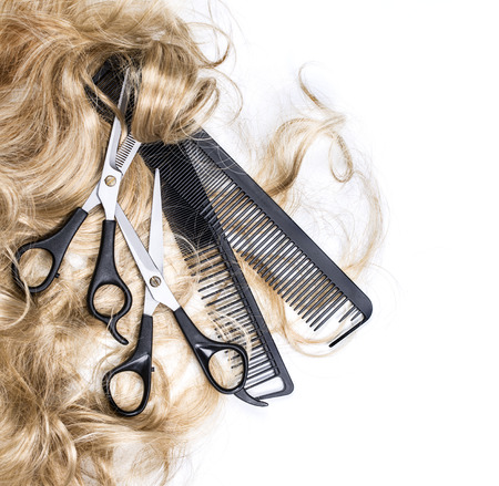 blonde streaks: Long blond hair and scissors isolated on white background Stock Photo