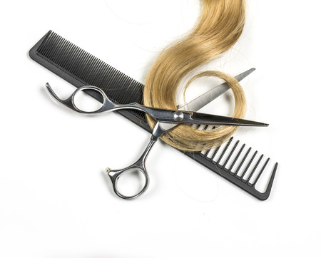 uncombed: Long blond hair and scissors isolated on white background Stock Photo