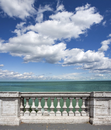 overlooking: empty terrace overlooking the sea with concrete balustrade.with clipping path Stock Photo